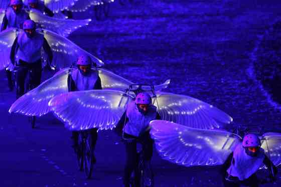 2012 Summer Olympics: Opening Ceremony - Dove bikes -- (Photo by: Paul Drinkwater/NBC)