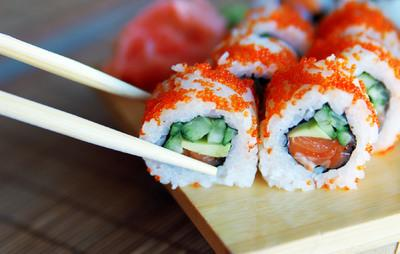 Sushi, a nutritious Japanese favorite, is made with sticky short-grain rice mixed with vinegar, salt, and sugar is topped with seafood, raw fish, vegetables or tofu and hand-rolled.  | iHaveNet.com