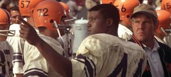 The Express (L to R, foreground) College football hero Ernie Davis (ROB BROWN) and Coach Ben Schwartzwalder (DENNIS QUAID) in a drama based on the true story of the running back who smashed barriers on and off the field The Express. Photo Credit: Universal Pictures Copyright: 2008 Universal Studios. ALL RIGHTS RESERVED.