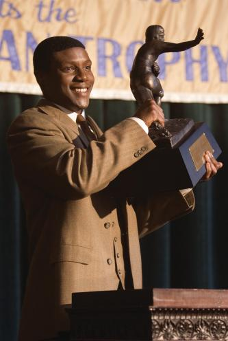The Express College football hero Ernie Davis (ROB BROWN) proudly holds the Heisman Trophy in a drama based on the true story of the running back who smashed barriers on and off the field - The Express. Photo Credit: Chuck Hodes Copyright: 2008 Universal Studios. ALL RIGHTS RESERVED