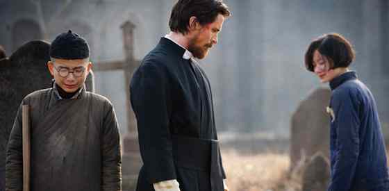 Christian Bale and Ni Niin The Flowers of War