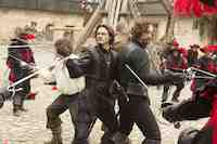 Logan Lerman and Milla Jovovich in The Three Musketeers