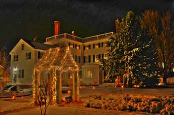 The Victorian Goodwin House and gardens with magical holiday lights at Strawbery Banke