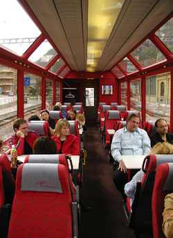 Riding the rails through Europe, such as in this panoramic train car in Switzerland, offers a relaxed way to connect with traveling Europeans