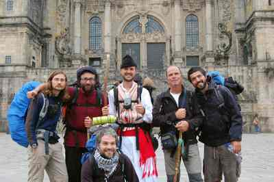 Happy hikers celebrate the end of their 500-mile pilgrimage in front of the Cathedral of St. James in Santiago, Spain.