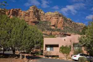 Enchantment's Casitas' adobe style matches the red rocks and juniper and pinion pines in Boynton Canyon.