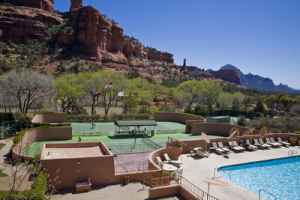 Enchantment's main pool and tennis courts, with the red-rock spire, Kachina Woman, at rear.