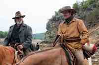 Jeff Bridges & Matt Damon  in the movie True Grit