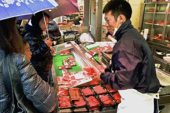 Vendor selling tuna fillets at the Tsukiji Fish Market