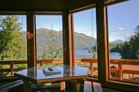 Guest chalets have floor to ceiling window views of Tutka Bay. Tutka Bay Lodge Alaska