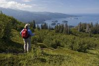 Hiker sees where Tutka Bay meets Kachemak Bay and Cook Inlet beyond. Tutka Bay Lodge Alaska