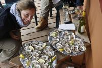 Enjoying fresh oysters and wine on the deck of Tutka Bay Lodge. Tutka Bay Lodge Alaska