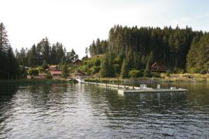 A water view of Tutka Bay Lodge�s dock, decks, and cottages. Tutka Bay Lodge Alaska