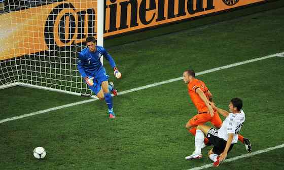KHARKOV, UKRAINE - JUNE 13: Mario Gomez of Germany is blocked off by John Heitinga of Netherlands during the UEFA EURO 2012 group B match between Netherlands and Germany at Metalist Stadium on June 13, 2012 in Kharkov, Ukraine. (Photo by Christopher Lee/Getty Images)