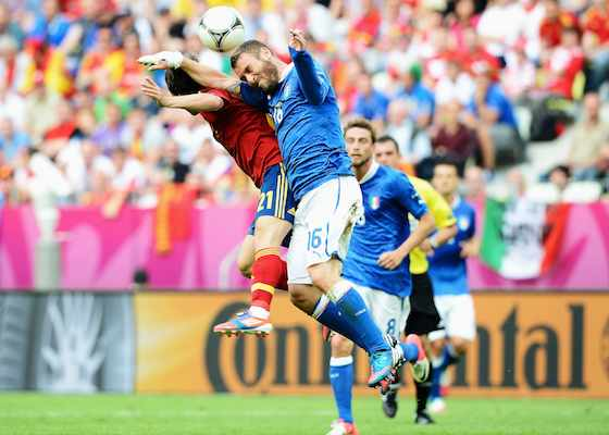 GDANSK, POLAND - JUNE 10: David Silva of Spain and Daniele De Rossi of Italy jump for the ball during the UEFA EURO 2012 group C match between Spain and Italy at The Municipal Stadium on June 10, 2012 in Gdansk, Poland. (Photo by Claudio Villa/Getty Images)
