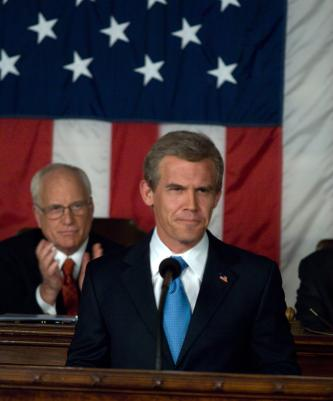 W Oliver Stone's Movie about George Bush George W. Bush (Josh Brolin, right) with Dick Cheney (Richard Dreyfuss, background left) in W. Photo credit: Sidney Ray Baldwin in W. Directed by Oliver Stones Photo Credit: Sidney Ray Baldwin