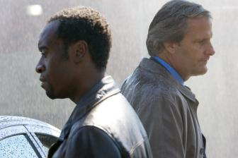 Traitor Movie Review Starring Don Cheadle, Guy Pearce, Neal McDonough, Jeff Daniels, Said Taghmaoui | Film Critic Michael Phillips Reviews Traitor | Video