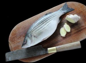 Fresh ginger root adds tang to vinaigrette sauce for striped bass fillets